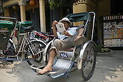 Hoi An, Vietnam. March 14th 2007..A cyclo-pousse driver takes a break.