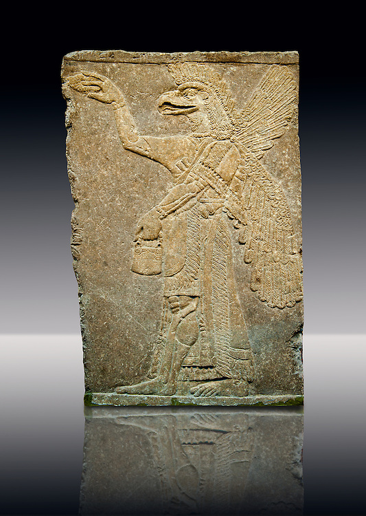 Assyrian relief sculpture panel of a protective spirit with an eagles Head from Nimrud, Iraq.  The spirit is holding a symbolic fir cone and is sprinkling holy water from the bucket it is holding. The rosette bracelet worn around the wrist symbolises divine power. 865-860 B.C North West Palace, Room I. ref: British Museum Assyrian  Archaeological exhibit WA 118921 .<br /> <br /> If you prefer to buy from our ALAMY PHOTO LIBRARY  Collection visit : https://www.alamy.com/portfolio/paul-williams-funkystock/ancient-assyria-antiquities.html  Refine search by adding background colour, place, subject, museum etc into the LOWER SEARCH WITHIN GALLERY box to <br /> <br /> Visit our ANCIENT ASSYRIAN PHOTO COLLECTIONS for more photos to download or buy as wall art prints https://funkystock.photoshelter.com/gallery-collection/Ancient-Assyrian-Art-Artefacts-Antiquities-Historic-Sites-Pictures-Images-of/C0000cjRqQyJjLag
