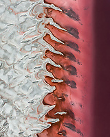 Aerial view of the abstract formations of salt by the banks of the Great Salt Lake seen pink only during some parts of the year in Utah, USA.