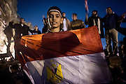 An Egyptian boy in Tahrir Square holds a flag moments after hearing the news of President Hosni Mubarak's resignation following nineteen days of protests.