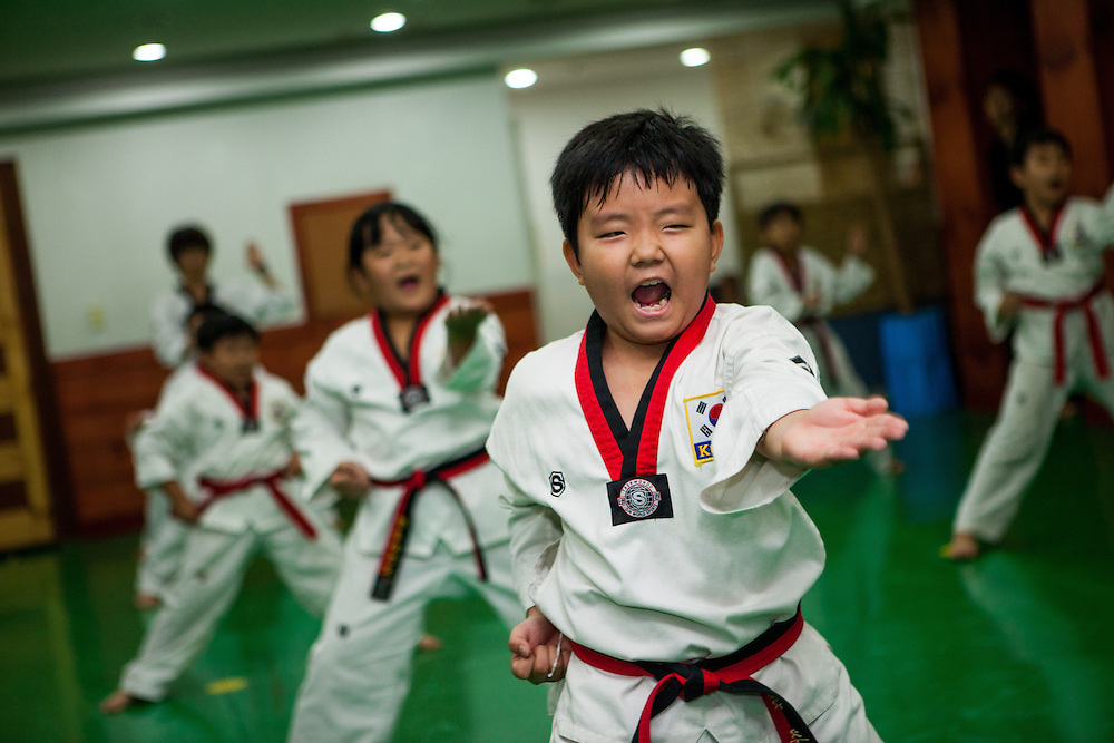 Training at a Taekwondo school for children in Daegu. Taekwondo is a Korean martial art and the national sport of South Korea.