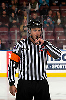 KELOWNA, BC - SEPTEMBER 28:  Referee Steve Papp blows he whistle on the ice at the Kelowna Rockets against the Everett Silvertips at Prospera Place on September 28, 2019 in Kelowna, Canada. (Photo by Marissa Baecker/Shoot the Breeze)