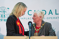 © Licensed to London News Pictures . 10/10/2014 . Heywood , UK . Labour candidate Liz McInnes congratulated by returning officer Carole Wardle (r) . The count at the Heywood and Middleton by-election , following the death of sitting MP Jim Dobbin . Photo credit : Joel Goodman/LNP