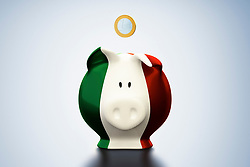 Euro coin above Italian flag piggy bank (Credit Image: © Image Source/Bjoern Holland/Image Source/ZUMAPRESS.com)