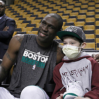 10 May 2012: Boston Celtics small forward Mickael Pietrus (28) poses with a young fan after giving him his sneakers prior to the Boston Celtics 83-80 victory over the Atlanta Hawks, in Game 6 of the Eastern Conference first-round playoff series, at the TD Banknorth Garden, Boston, Massachusetts, USA.