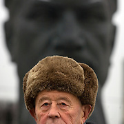 """Portrait of Pavel Egorenkov, head of laboratory at the Kurchatov Institute in Moscow..Egorenkov, in his 80s, is considered """"The grandfather of Russian nuclear reactors"""", as he had a hand in designing them. .Egorenkov is standing in front of a statue of Igor Vasilyevich Kurchatov (1903 ñ  1960), the leader of the Soviet atomic bomb project."""