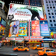 Taxi cabs and bright billboards in Times Square in New York City, New York, USA