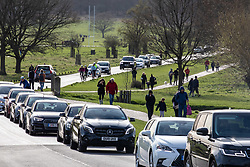 © Licensed to London News Pictures. 21/03/2020. London, UK. Walkers out in Richmond Park today as the roads jam up with cars. As the City centre empties, traffic jams build up in South West London, as walkers, runners and families descend on Richmond Park to exercise during the coronavirus crisis. Photo credit: Alex Lentati/LNP