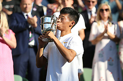 Chun Hsin Tseng with the Trophy after winning the Boys' Singles Final on day thirteen of the Wimbledon Championships at the All England Lawn Tennis and Croquet Club, Wimbledon.