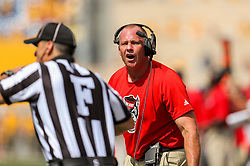 Sep 14, 2019; Morgantown, WV, USA; North Carolina State Wolfpack head coach Dave Doeren runs down the sideline and attempts to call a timeout during the second quarter against the West Virginia Mountaineers at Mountaineer Field at Milan Puskar Stadium. Mandatory Credit: Ben Queen-USA TODAY Sports