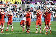 Southampton players applaud  the fans at full time after beating Swansea City.<br /> Barclays Premier league match, Swansea city v Southampton at the Liberty stadium in Swansea, South Wales on Saturday 3rd May 2014.<br /> pic by Phil Rees, Andrew Orchard sports photography.