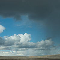 WASHINGTON.  Winter storm clouds tower above coulee country west of Spokane.