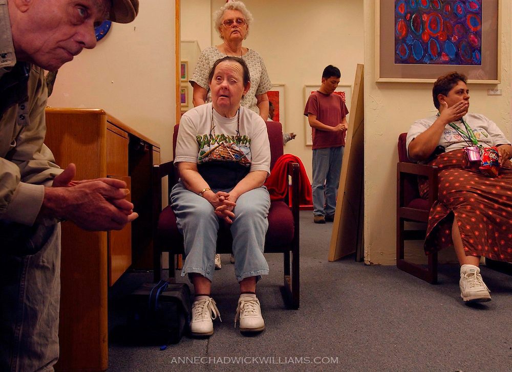Irene Pinole, 76, center, and other artists at the Short Center South, a fine arts center for the disabled, take a lunch break.  Pinole is one of the oldest living people with Down Syndrome. Anne Chadwick Williams / May 2004/ Sacramento Bee