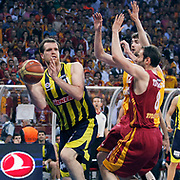 Fenerbahce Ulker's Oguz SAVAS (L) during their Turkish Basketball league Play Off Final fourth leg match Galatasaray between Fenerbahce Ulker at the Abdi Ipekci Arena in Istanbul Turkey on Saturday 11 June 2011. Photo by TURKPIX