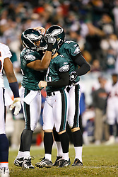 Philadelphia Eagles PK David Akers #2 is congratulated by teammates Sav Rocca and Alex Smith during the NFL game between the Denver Broncos and the Philadelphia Eagles on December 27th 2009. The Eagles won 30-27 at Lincoln Financial Field in Philadelphia, Pennsylvania. (Photo By Brian Garfinkel)