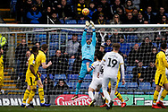 Simon Eastwood of Oxford United tips the ball the net  during the EFL Sky Bet League 1 match between Oxford United and Peterborough United at the Kassam Stadium, Oxford, England on 16 February 2019.
