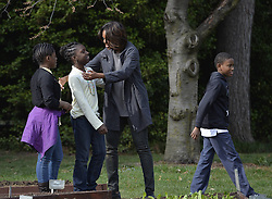 61337998<br /> U.S. First Lady Michelle Obama gives goodbye hugs to school children in the White House Kitchen Garden on the South Lawn of the White House in Washington D.C., capital of the United States, April 2, 2014. U.S. First Lady Michelle Obama joined FoodCorps leaders and local students to plant the White House Kitchen Garden for the sixth year in a row. USA,  Wednesday, 2nd April 2014. Picture by  imago / i-Images<br /> UK ONLY