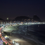 Praia de Copacabana at dusk. Copacabana beach, one of the world's most famous urban beaches at dusk. The beach and hotel strip stretches for 1.5 miles (4km) from the Morro do Leme at the Northern end, to Arpoador. Copacabana beach, Rio de Janeiro,  Brazil. 20th July 2010. Photo Tim Clayton..