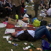 A man sleeps on the ground during the race meeting at Royal Ascot Race Course. Royal Ascot is one of the most famous race meetings in the world, frequented by Royalty and punters from the high end of society to the normal everyday working class. Royal Ascot 2009, Ascot, UK, on Saturday, June 20, 2009. Photo Tim Clayton..