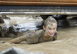 March 31, 2019 - Christchurch, Canterbury, New Zealand - Participants of all ages, some of them in costumes, get good and muddy in the Muddy Good Run, which had them going over, under and through a variety of obstacles. Events included 5k and 10k races for adults and a 1.5k fun run for youngsters. (Credit Image: © PJ Heller/ZUMA Wire)