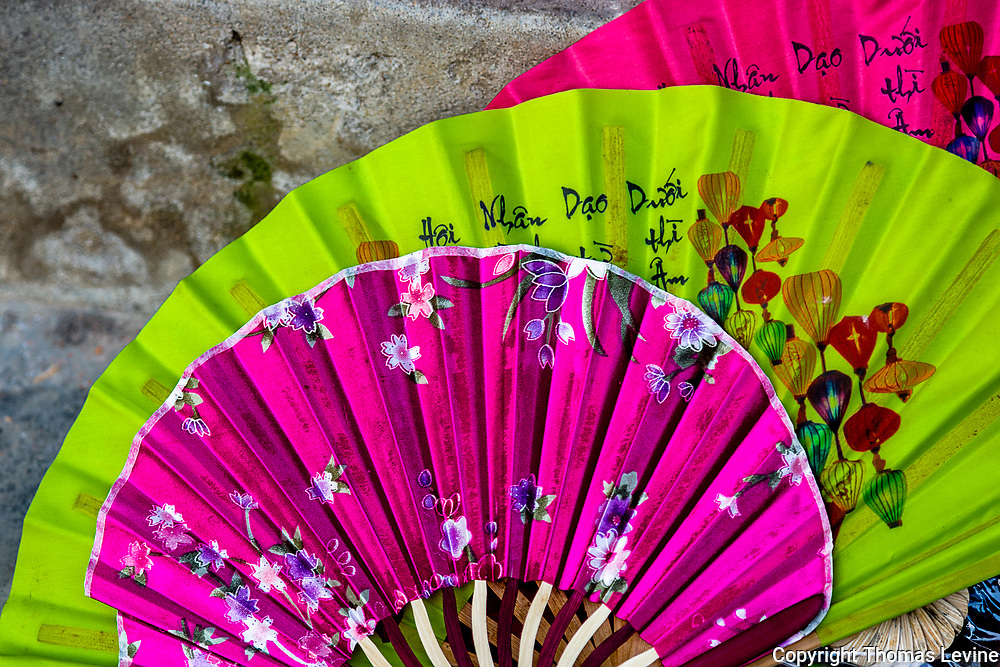 Decorated Asian Fans with cultural images.