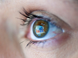 website logo from most popular Chinese search engine Baidu  reflected in womans eye from computer screen