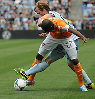 Football - Major League Soccer - Houston Dynamo at Sporting KC - The Sporting KC and the Houston Dynamo played to a 1-1 tie in regulation time at Sporting KC Park in Kansas City, Kansas, USA. Houston Dynamo midfielder Boniek Garcia (27) and Sporting KC defender Seth Sinovic (15) fight for the ball in the first half. .