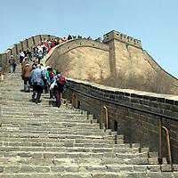 Asia, China, Beijing. Visitors climbing steps at the Great Wall