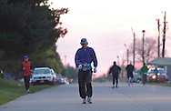 Augusta, New Jersey - Robert Lebrun, center, and other runners compete in 48- and 72-hour races during the 3 Days at the Fair races at Sussex County Fairgrounds before dawn on May 13, 2012. Lebrun finished with 176 miles in the 72-hour race.