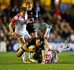 Matt Smith (Leicester) is tackled to ground - Photo mandatory by-line: Patrick Khachfe/JMP - Tel: Mobile: 07966 386802 18/01/2014 - SPORT - RUGBY UNION - Welford Road, Leicester - Leicester Tigers v Ulster Rugby - Heineken Cup.