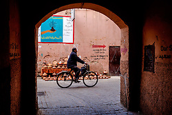 A Moroccan man cycles through the Medina in Marrakech, Morocco, North Africa<br /> <br /> <br /> (c) Andrew Wilson | Edinburgh Elite media