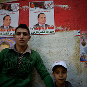 Children stanby campaign posters outside the polling station in Darode El Farag secondary school in Cairo's Shubra district.