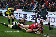 DTH Van Der Merwe of Scarlets dives over in the corner to score his 1st half try as Dan Baker of the Ospreys attempts to stop him. . Guinness Pro12 rugby match, Ospreys v Scarlets at the Liberty Stadium in Swansea, South Wales on Saturday 26th March 2016.<br /> pic by  Andrew Orchard, Andrew Orchard sports photography.