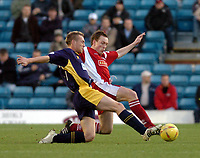 Picture: Henry Browne.<br />Date: 13/12/2003.<br />Wimbledon v Walsall Nationwide First Division.<br />Darren Wrack of Walsall goes into a tackle with Dons' Adam Nowland