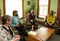 Jacqui Abikoff -Horizons, Senator Jeanne Shaheen, Carmen Lorentz -Lakes Region Community Development and Daisy Pierce -Navigating Recovery sit down with counselors and residents from the Compass House on Tuesday afternoon.  (Karen Bobotas Photo/for The Laconia Daily Sun)