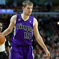 21 December 2009: Sacramento Kings guard Beno Udrih looks for a teammate during the Sacramento Kings 102-98 victory over the Chicago Bulls at the United Center, in Chicago, Illinois, USA.