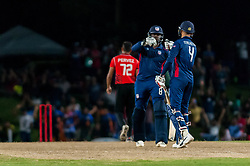 September 22, 2018 - Morrisville, North Carolina, US - Sept. 22, 2018 - Morrisville N.C., USA - Team USA JASKARAN MALHA (4) and STEVEN TAYLOR (8) bump fists in the Super Over during the ICC World T20 America's ''A'' Qualifier cricket match between USA and Canada. Both teams played to a 140/8 tie with Canada winning the Super Over for the overall win. In addition to USA and Canada, the ICC World T20 America's ''A'' Qualifier also features Belize and Panama in the six-day tournament that ends Sept. 26. (Credit Image: © Timothy L. Hale/ZUMA Wire)