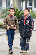 Young boys in the playground of a primary school in Fuli. China has a one child policy to limit population.