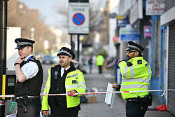 © Licensed to London News Pictures. 21/02/2018. London, UK. The scene on Malden Road, Camden, where one of two stabbings took place yesterday evening, killing two young men. Police were called to a second disturbance in the area, in which a second man was stabbed to death, and are currently investigating if the two incidents are connected. Photo credit: Ben Cawthra/LNP