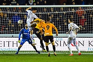 Daniel Ayala (4) of Middlesbrough leaps above Jamille Matt (11) of Newport County during the The FA Cup match between Newport County and Middlesbrough at Rodney Parade, Newport, Wales on 5 February 2019.