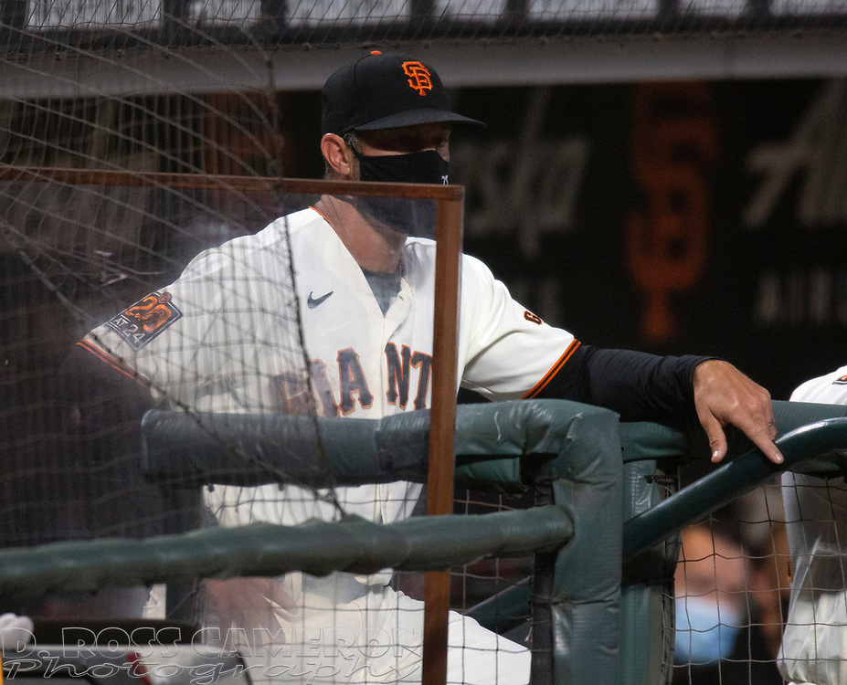 Sep 16, 2020; San Francisco, CA, USA; San Francisco Giants manager Gabe Kapler (19) watches his team take on the Seattle Mariners during the second inning of a baseball game at Oracle Park. Mandatory Credit: D. Ross Cameron-USA TODAY Sports
