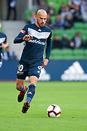 Melbourne Victory midfielder James Troisi (10) runs the ball at the Hyundai A-League Round 2 soccer match between Melbourne Victory and Perth Glory at AAMI Park in Melbourne.