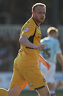 Lee Minshull of Newport celebrates scoring his side's equalising goal. Skybet football league two match, Newport county v Exeter city at Rodney Parade in Newport, South Wales on Sunday 16th March 2014.<br /> pic by Mark Hawkins, Andrew Orchard sports photography.