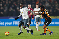 Manchester United's Paul Pogba (left) and Hull City's Tom Huddlestone battle for the ball during the EFL Cup Semi Final, Second Leg match at the KCOM Stadium, Hull.
