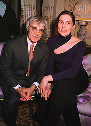 MR & MRS BERNIE ECCLESTONE he is the Formula 1 racing supremo, at a party in London on 14th December 1998.MMY 17