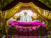 """08 FEBRUARY 2015  BANGKOK, THAILAND:  A man studies Sikh texts in a Guru Granth Sahib at the Sikh temple in Bangkok. Thailand has a small but influential Sikh community. Sikhs started coming to Thailand, then Siam, in the 1890s. There are now several thousand Thai-Indian Sikh families. Gurdwara Siri Guru Singh Sabha was established in 1913. Construction of the current building, adjacent to the original Gurdwara (""""Gateway to the Guru""""), started in 1979 and was finished in 1981. The Sikh community serves a daily free vegetarian meal at the Gurdwara that is available to people of any faith and background.   PHOTO BY JACK KURTZ"""