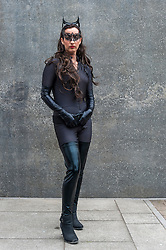 © Licensed to London News Pictures. 24/05/2015. London, UK. A woman dressed as Catwoman poses, as fans of anime, comic books, video games and more gather in large numbers at the Excel Centre to attend the bi-annual MCM Comic Con. Photo credit : Stephen Chung/LNP