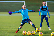 Steven Naismith (#14) of Heart of Midlothian FC stretches for a ball during the Heart of Midlothian press conference and training session at Oriam Sports Performance Centre, Edinburgh, Scotland on 23 November 2020.