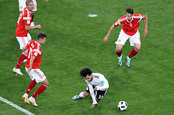 Egypt's Mohamed Salah (bottom) goes down in the box, resulting in a penalty with help from VAR during the FIFA World Cup 2018, Group A match at Saint Petersburg Stadium.