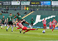 Plymouth Argyle Defender Jerome Opoku (24) diving defending tackle  during the EFL Sky Bet League 1 match between Plymouth Argyle and Sunderland at Home Park, Plymouth, England on 1 May 2021.